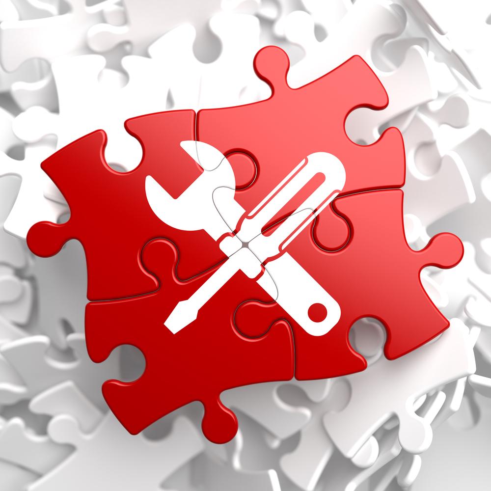 TYPO3 Update Sicherheit - Puzzlestücke mit Werkzeug